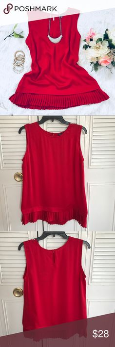 "Tommy Hilfiger Women sleeveless ruffle red blouse This women sleeveless blouse is come in a red color. It's sleeveless, round neck with an attach button on the back of the neck. It feature plain on the top and ruffle style around the bottom of the shirt. See picture. Brand new with tag. Never wear.  Shoulder to bottom: 25"" Chest: 19"" Material: 100% Polyester  Measurement are base on item lay flat on the floor Best offer accept. Tommy Hilfiger Tops Blouses"
