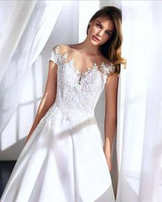 Elegant ballgown wedding dress with illusion neckline Illusion Neckline Wedding Dress, Illusion Dress, Wedding Dress Styles, Designer Wedding Dresses, Bridal Gowns, Wedding Gowns, Lace Veils, Bridal Stores, House Dress