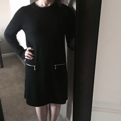 Black Tahari dress w/ modern embellishments Gorgeous black dress with shoulder detailing and exposed zippers on faux pockets. Size M. Excellent condition, only minor wear. 100% extrafine merino wool - unbelievably soft! Easy, comfortable, but very chic and professional business/business casual dress. Tahari Dresses Long Sleeve