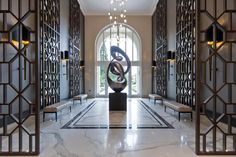 A luxurious lobby area for a grand residential development in Surrey, featuring both classical and luxurious interiors by Alexander James Interior Design.