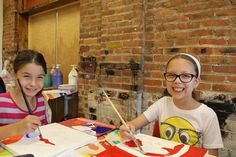 Campers working on their projects during Summer Multimedia Camp