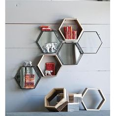 Fantastic wall ornamentation that is beautiful and functional. Each little box could a memento box with bits., bobbles, and photos from a trip or someone you lost. Eco Honeycomb shelves- Set of 3 $65