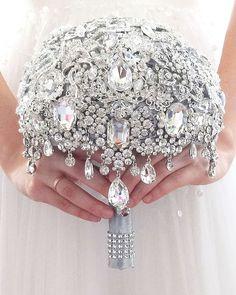 Are floral bouquets a thing of the past?   Probably not, but this draped jewel bouquet is stunning and a true keepsake.   Photo by #MemoryWedding via ETSY..#weddingforward #enchantedforestweddings #sandiegowedding #temeculawinecountry #temeculawedding #socalweddingplanner #castlewedding #visittemecula #deluz