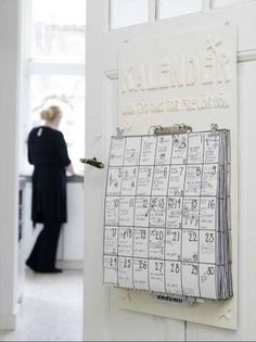 DIY Family Calendar using large strips of paper & binder clips