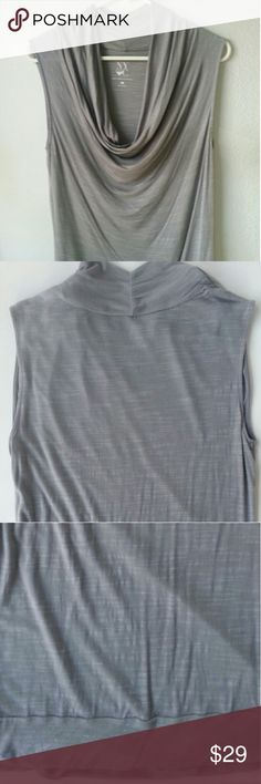 NY & Co gray sleeveless drop collar top New York & Company sleeveless gray with professional but sexy drop collar. Looks brand new! Very attractive top that you could wear with dark jeans and heels, or boots. Also looks great with work attire!  Feel free to ask questions...please no paypal/no trades/no offline transactions/see something but the price is too high, make an offer! Items that are bundled are welcome! New York & Company Tops Blouses
