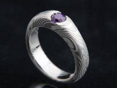 Mokume Gane (different layered using an ancient Japanese swordsmithing technique) engagement ring by James Binnion.