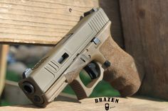 Modified Hot Rod cuts with louver windows on the top of the slide, and side pockets. Custom FDE and OD Green Cerakote Slide. Carry Stipple with double undercuts and index shelf cuts.