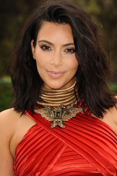Kim's thick, choppy lob was a refreshing and sophisticated change from her long hair.   - HarpersBAZAAR.com