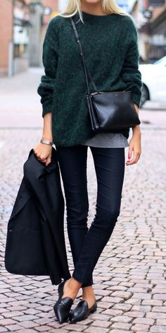 minimalist; oversized soft grey sweater layered a grey top + grey/black skinny jeans + glossy black flats.
