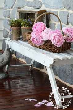 Farmhouse style with rustic bench, basket of peonies and shabby chic planters. |StoneGable