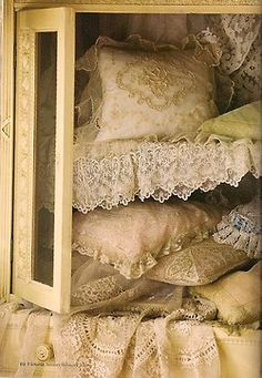 Lovely cabinet of old lace & linen