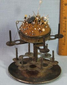 VINTAGE PIN CUSHION WITH 10 THREAD SPOOL HOLDERS