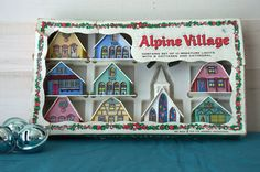 These plastic Putz houses were the offspring of the cardboard, glitter houses. It is a complete, original set. It is rare to find them in this