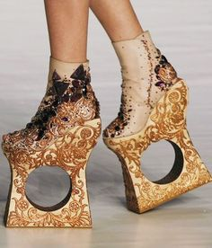 A person MIGHT be able to walk in these, but why?