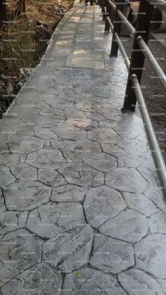 Stamped concrete is concrete that is patterned and/or textured or embossed to resemble brick, slate, flagstone, stone, tile, wood, and various other patterns and textures. Stamped concrete is commonly used for patios, sidewalks, walkways, driveways, pool decks, and interior flooring. The ability of stamped concrete to resemble other building materials makes stamped concrete a less expensive alternative to using those other authentic materials such as stone, slate or brick.
