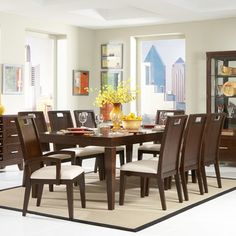@Overstock - Beautiful and practical, this solid rubberwood dining set features a beautiful cherry finish and a durable, solid wood construction. Six side chairs and two arm chairs are included in this dining furniture set.http://www.overstock.com/Home-Garden/Silves-9-piece-Dark-Brown-Family-Dining-Set/5535120/product.html?CID=214117 $1,505.99