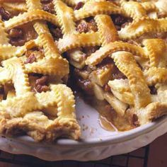 Praline-Taffy Apple Pie: Creamy caramels nestle between layers of tart cooking apples and a mixture of brown sugar, pecans and melted butter.