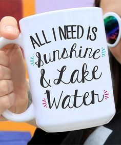 An eye-catching graphic brings lighthearted charm to this clever ceramic mug that features an extra large construction for thirst-quenching capacity. Full graphic text: All I need is sunshine and lake waterHolds 15 oz.