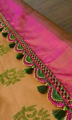 20 Ways to Style your Saree Pallu with Kuchu Designs Tassels are also known as Kuchu or Latkans, A quite popular word and grabbing attention nowada… Saree Tassels Designs, Saree Kuchu Designs, Saree Blouse Neck Designs, Bridal Blouse Designs, Fancy Blouse Designs, Hand Embroidery Videos, Embroidery Saree, Embroidery Patterns, Seda Sari
