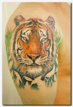 Tiger tattoos are getting popular these days not only for men but also for women. People love tiger tattoos for the very symbolic meaning – a tiger tattoo represents strength. Below, we are going to mention tiger face tattoo designs and ideas. Tiger Tattoo Small, Tiger Tattoo Thigh, Tiger Eyes Tattoo, Mens Tiger Tattoo, Big Cat Tattoo, Tigergesicht Tattoo, Tattoos Masculinas, Kunst Tattoos, Bild Tattoos