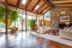 Home Improvement Archives Home Improvement Archives Rustic Living Room with stone fireplace, Pendant Light, Exposed beam, f Atrium, Dream Home Design, House Design, Modern Exterior Lighting, House Yard, Pole Barn Homes, Stone Houses, Tropical Houses, Home Living Room