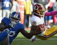 Robert Griffin III gets sacked by Giants defensive end Jason Pierre-Paul during Washington's 27-23 loss at the New York Giants.  Toni L. Sandys / The Washington Post http://www.kingsofsports.com/
