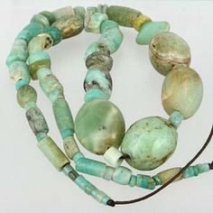 Old Amazonite Bead Strand. Hard to find old amazonite collected from Afghanistan. Strand contains one glass bead & one green agate bead.