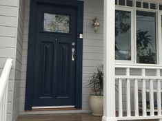 Hume front door and painted in Taubmans Elegant Evening. Walls Milton Moon by Dulux