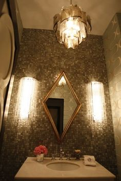 love the wall of tiles.... from glam at home blog
