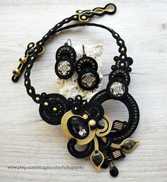 Check out this item in my Etsy shop https://www.etsy.com/listing/567218543/black-and-gold-soutache-necklace-and