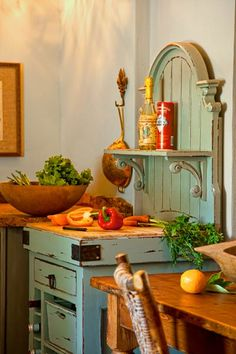 A freestanding storage piece with a butcher-block prep surface adds vintage style and modern function.   Photo: Deborah Whitlaw Llewellyn   thisoldhouse.com