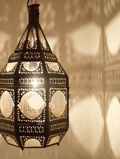 550mm high x 250mm wide.  A large and very beautiful oxidized tin lantern which can be used either as a hanging lantern or as a candle lamp. Has a clear glass bottom. A very traditional style lantern handcrafted in Marrakech.  Does not include any electrical fittings.  Ceiling roses with hook available online.