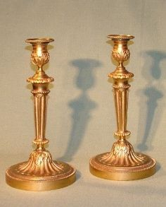 The many styles of antique candlestick through the ages:  http://www.antiquefurniture.net/blog/the-various-eras-and-styles-of-antique-candlesticks-2863
