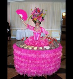 Strolling Tables glide through your party serving hors d'oeuvres! Living tables are perfect for corporate events weddings birthdays and sweet 16s. | Screaming Queens Drag Entertainment