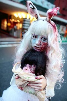This guro lolita scares me. I wonder if there is a horror movie involving lolita zombies....that would be awesome! :D & scary....