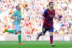 Lionel Messi of FC Barcelona celebrates after scoring the opening goal during the La Liga match between FC Barcelona and Real Betis Balompie at Camp Nou on April 5, 2014 in Barcelona, Catalonia.