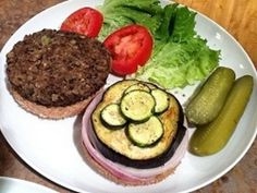 Lentil Burger - Home made Lentil patty with roasted Eggplant, sauteed Zucchini, and fresh red onions on a whole wheat bun. Accompanied by lettuce, tomato, and pickles. It was goooood. ; ) - VeganSoulFood.info