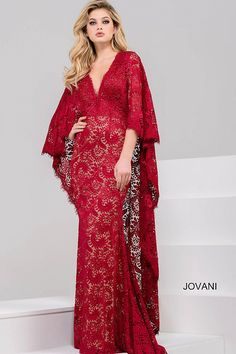 02fa6abd132 Elegant floor length form fitting cranberry lace evening dress with nude  underlay features v neckline and lace cape overlay.