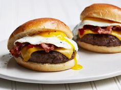 Get Bacon, Egg and Cheese Breakfast Burgers Recipe from Food Network Egg And Cheese Sandwich, Bacon Egg And Cheese, Breakfast Burger, Breakfast Recipes, Breakfast Sandwiches, Breakfast Items, Morning Breakfast, Beef Recipes, Cooking Recipes