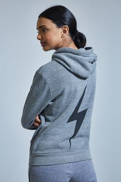 Aviator Nation's signature worn in vintage feel makes every piece a must-have for those who seek cozy vibes. The Bolt Zip Hoodie is a timeless and versatile top layer with pockets and an ultra-relaxed fit. Finished with a black bolt graphic, this hoodie i Zip Hoodie, Black Bolt, Hoodies, Sweatshirts, Heather Grey, Active Wear, Model, Sweaters, How To Wear