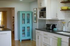 Sandra and Justin's Kitchen: The Big Reveal - Cute extra cabinet in a punchy color