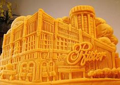 A sculpture made out of Cheddar Cheese by Sarah Kaufmann.