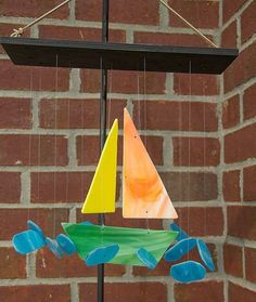 This stained glass #sailboat wind chime sounds like a bell ringing when the 'water' pieces gently hit the boat. So awesome! by kims_creations_in__sc