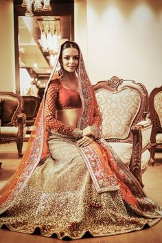 Red and gold bridal lehenga.  Indian wedding outfit