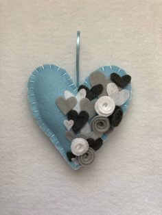A personal favorite from my Etsy shop https://www.etsy.com/listing/580964932/mothers-day-heart-felt-ornament