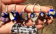evil eye lamp work glass bead!! handmade with love by me!! evil eye and leather bracelets