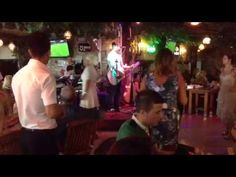 Nightlife at Planet Yucca Kusadasi - good food, live music and entertainment every night of the season. Sercan and the band with 'Wake Me Up'.