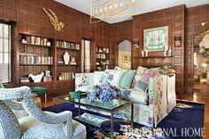 A vintage Hermès scarf—framed and hung above the fireplace—inspired the feminine hues found in this library. - Photo: Peter Rymwid / Design: Michelle Workman