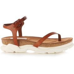 c74d4f9d4db8 Stella McCartney s tan-brown faux-leather Altea sandals are a modern take  on classic athletic styles. They have a sleek crossover thong strap and are  ...