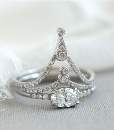 Reminiscent of the swooping architecture of the Eiffel Tower, the Amélie Stack shines with cascading diamonds and an unconventional solitaire diamond setting. Two glistening nesting bands accentuate the simplicity of the oval solitaire set playfully on its side in an East/West platinum mounting. This dramatic, vintage inspired stack makes the most elegant statement when worn together!